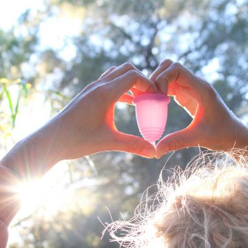 Woman holding menstrual cup